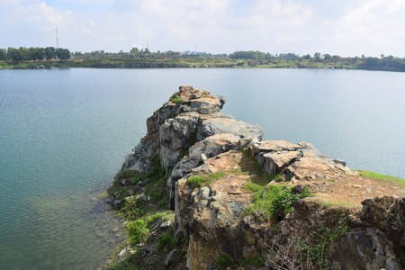 rocky lake with stone and cliff near Ho Chi Minh city, vietnam Stock Photo