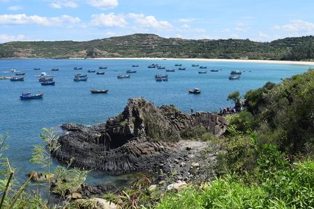 Vietnamese natural heritage Ganh Da Dia sea with fishing boats in Tuy Hoa, Phu Yen
