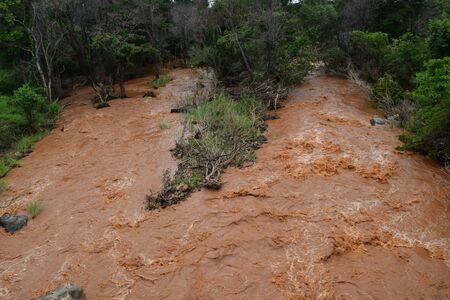alluvial: floody river with red alluvial strongly flowing in Dak Lak, vietnam