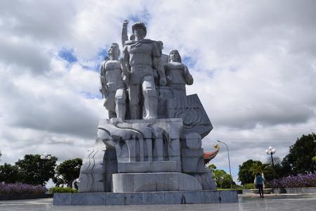 statue of soldier, farmer, worker united in vietnam