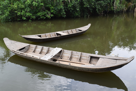 uncomplicated: traditional asian fishing boat in river, vietnam