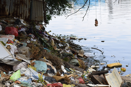 excremental: polluted river water with many domestic trash Stock Photo