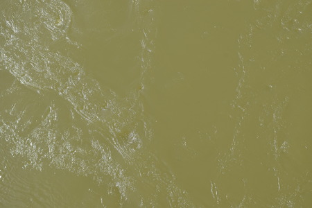 alluvial: natural alluvial water flowing with straw colored background