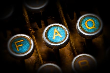 close up on old blue faq typewriter keys photo