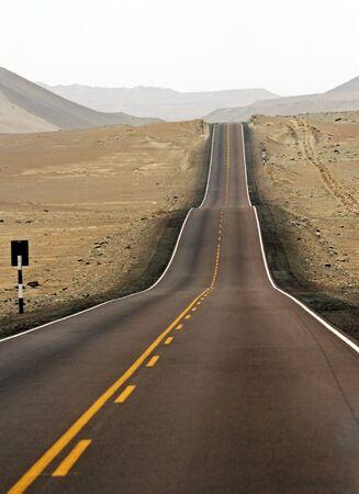 asphalt street in the midle of desert photo