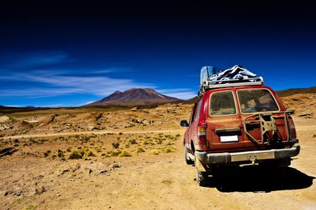 Bolivia , dramatic landscape, vehicle in the desert and mountain photo