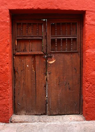 detail of red wall and wood door photo