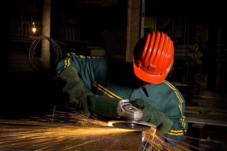 heavy industry manual worker with grinder background photo