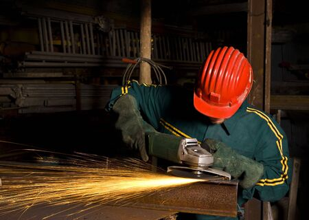 heavy industry image manual worker with grinder background Stock Photo - 3760583