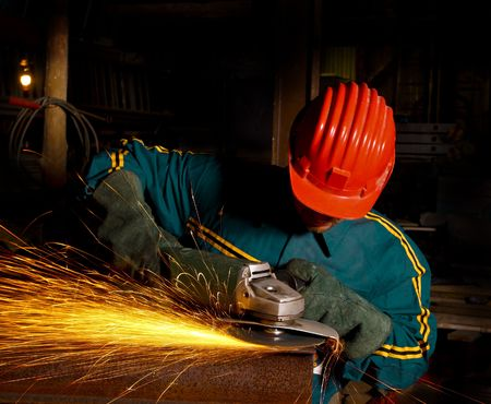 heavy industry manual worker with grinder photo