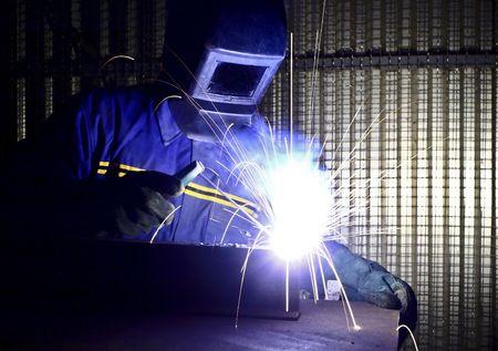 fine image of welder of work