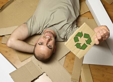 man on wood floor hold  recycling symbol on cardboard Stock Photo - 3976066