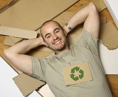 man on wood floor and   recycling symbol on cardboard Stock Photo - 3976067