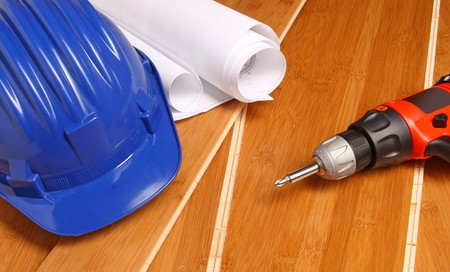 helmet, drill and blueprint on wood bamboo aces Stock Photo - 4030254