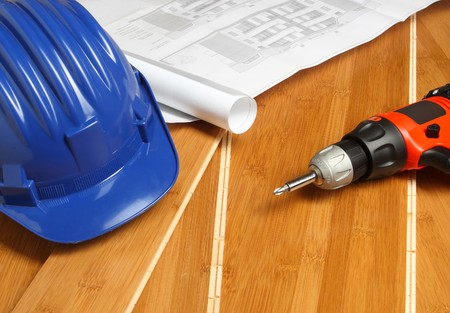 blue helmet, red drill and bluprint on wood floor Stock Photo - 4030255