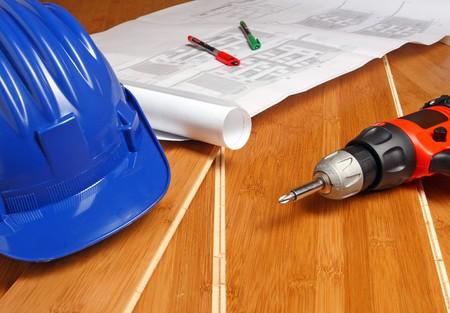 work tools, helmet and blueprint on wood bamboo floor Stock Photo - 4030256
