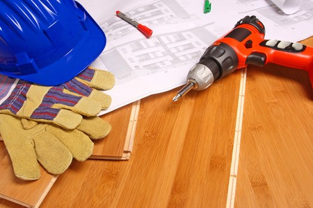helmet, gloves, drill and blueprint on wood floor Stock Photo - 4030258