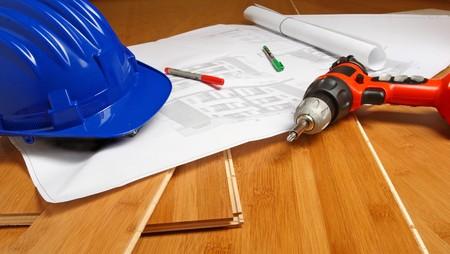 fine image of blue helmet, drill, blueprint on wood background Stock Photo - 4030251