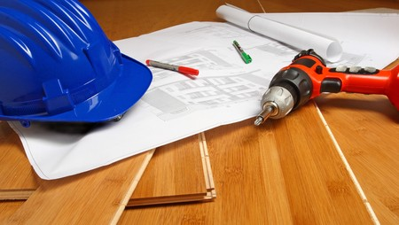 fine image of blue helmet, drill, blueprint on wood background Stock Photo - 4030251