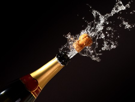 champagne bottle with shotting cork background Stock Photo