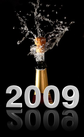 champagne bottle with shotting cork background 2009 new years photo