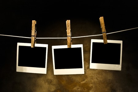 classic old photos Held By Clothespins with grunge background Stock Photo - 4126215