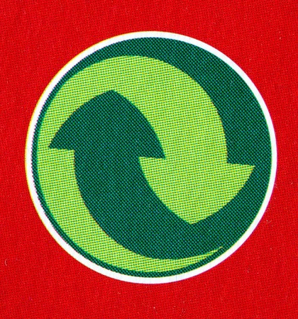 fine image close up of green recycle symbol on red Stock Photo - 4126234