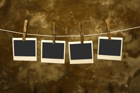 classic old polaroid photo Held By Clothespins with grunge background Stock Photo - 4148009