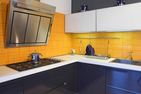 fine image of modern wood kitchen with orange tiles photo