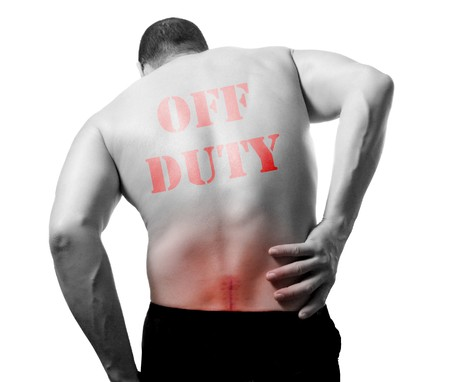 affliction: young man with back pain is off duty isolated on white