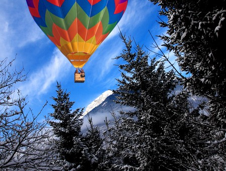 image of alps, Mountain in winter time background with colorful hot air balloon photo