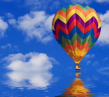 fine image of white clouds and blue sky and air balloon