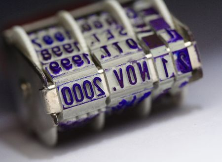 up date: close up image of classic date office stamp