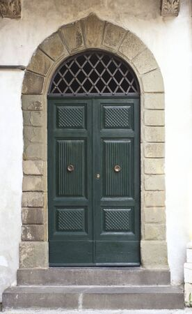 medioeval: green classic door in Lucca, tuscany Italy medioeval town Stock Photo