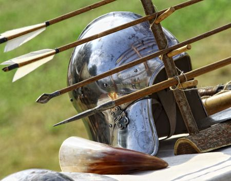 past civilizations: close up of ancient metal helmet and arrows  background Stock Photo