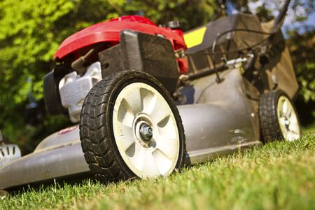 detail of classic Lawn Mower on green grass background
