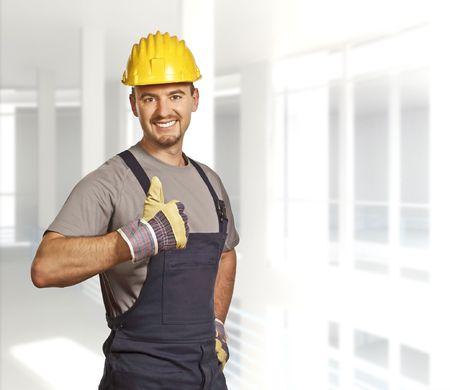 journeyman technician: fine portrait of young caucasian handyman background