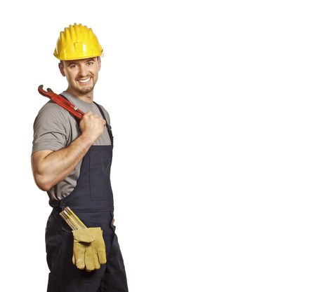 journeyman technician: fine portrait of caucasian smiling handyman isolated on white Stock Photo