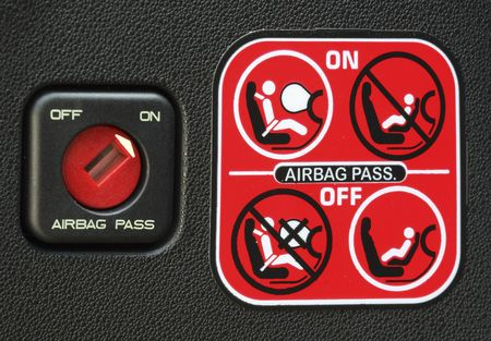 staying in shape: close up image of airbag stickers of modern car