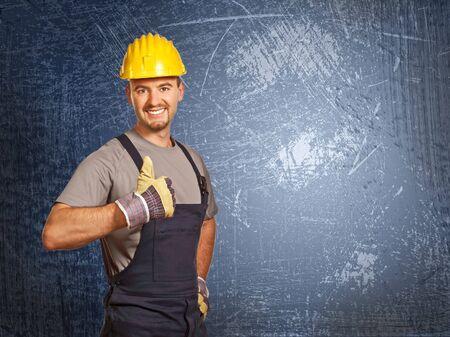 positive pose of handyman and grunge background photo