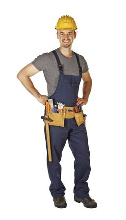 toolbelt: confident pose of young caucasian handyman with toolbelt