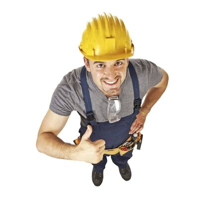 young positive handyman thubm up, view from above Stock Photo - 5174634