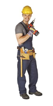 young caucasian manual worker smile and hold red drill tool photo