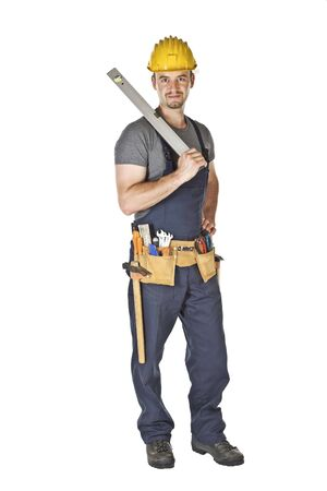 standind handyman holding spirit level isolated on white photo