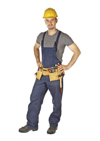 standing young caucasian manual worker on white background photo
