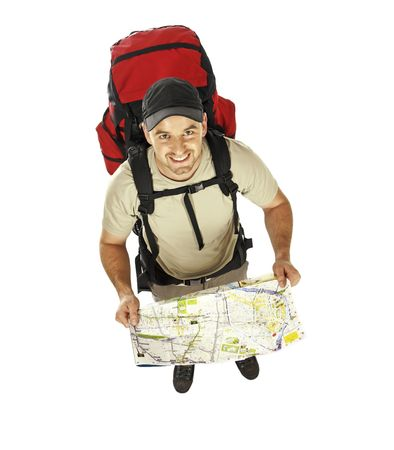 travel image of young caucasian man with big backpack and map in his hands Stock Photo - 5204547