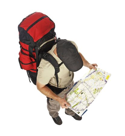 backpackers: travel image of young caucasian man with big backpack and map in his hands Stock Photo
