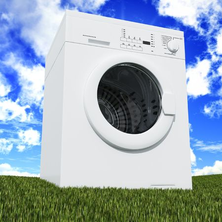 fine 3d washing machine with blue cloudy sky and green grass photo