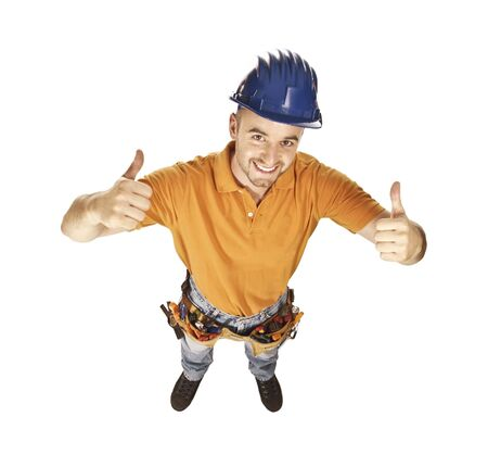 isolated young caucasian handyman thinking positive and smiling photo