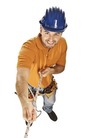 journeyman technician: isolated young caucasian handyman pull rope and smiling